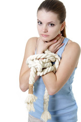 young woman with tied up hands over white