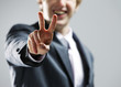 young businessman hand showing the victory sign.