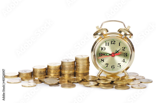 Alarm clock and money isolated on white background