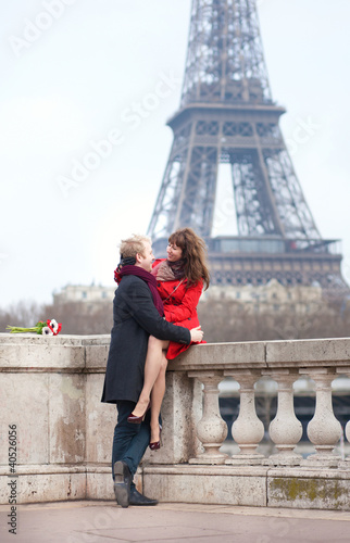 Romantic couple in love dating near the Eiffel Tower