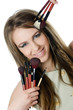 The beautiful girl with brushes for a make-up