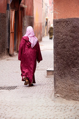 lady in traditional dress walking in street