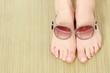 Female feet and sunglasses