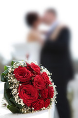 Newly-married couple and wedding bouquet.