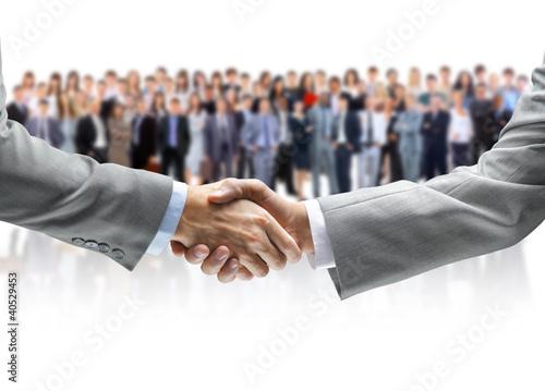 Händeschütteln und Business-Team