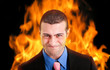 Angry businessman with flames on the backgrond
