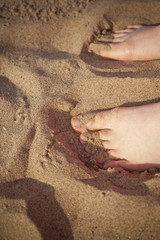 warm sand of the beach with bare feet