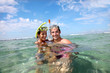 Portrait of happy couple doing snorkeling - 40530263