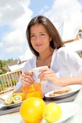 Portrait of beautiful young woman having breakfast