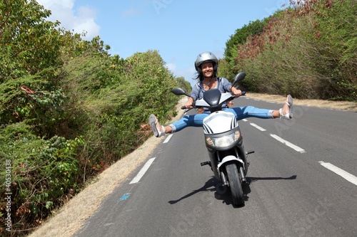 Young woman riding motorbike