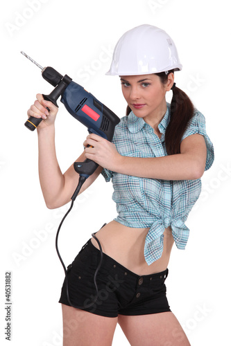 sexy woman using a power drill