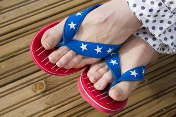 Flag patterned flip flop shoes