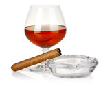 Cognac in glass with cigar and ashtray isolated