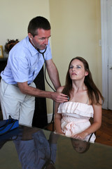 Doctor Doing A Examination of the lungs with a stethoscope