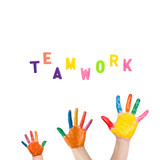 "Three colorful hands drawn to the word ""teamwork"""