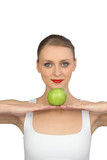 Woman balancing an apple in her hands