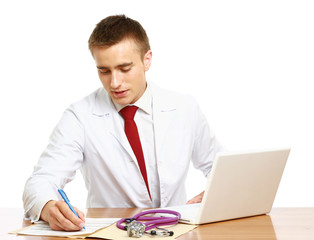 Medical doctor working on his workplace over white