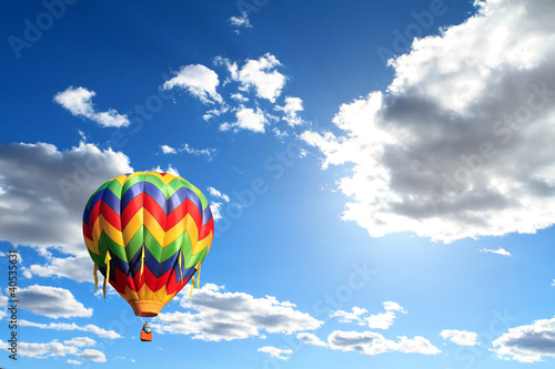 hot air balloon over cloudy sky
