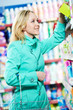 woman at household chemistry shopping supermarket