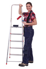 Painter posing with a stepladder and paint roller