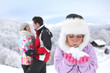 happy couple and daughter at ski resort