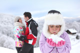 happy couple and daughter at ski resort