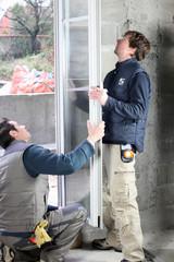 Two men installing new windows