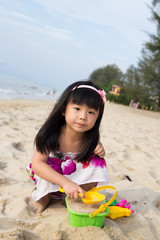 Little girl playing sand