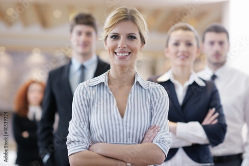 business woman standing with her staff at conference