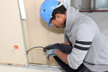 Man working on houses electrics