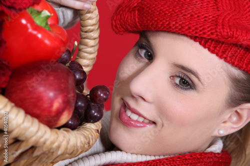 Woman holding fruit basket