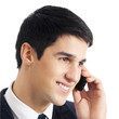 Businessman with cellphone, isolated