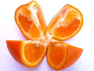 sliced juicy orange isolated on white background