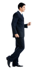 Full body of walking businessman, isolated