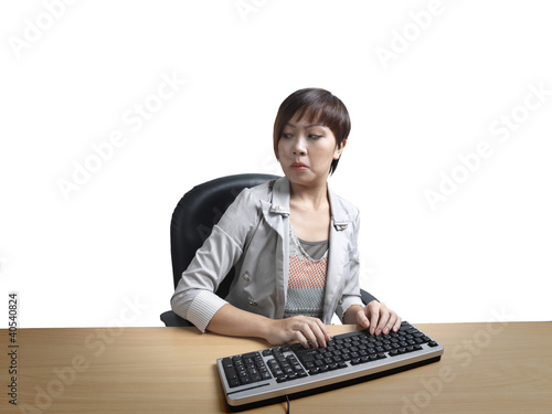 Annoyed office worker overlooking shoulder