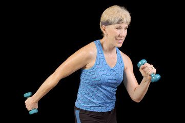 Attractive baby-boomer exercising with weights