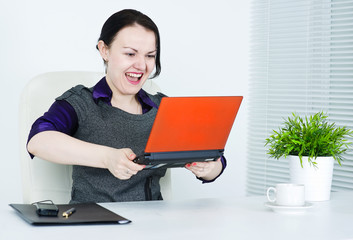 Business woman angry on computer