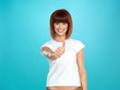 attractive woman smiling with her thumb up