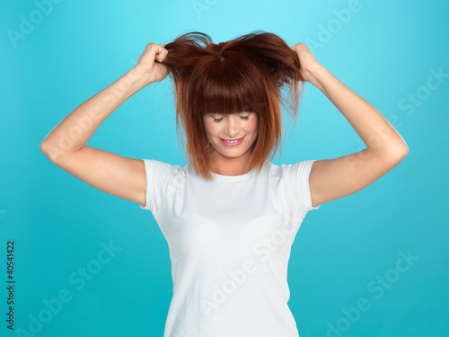 attractive woman pulling her hair