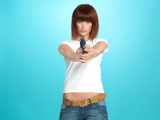 pretty young woman pointing the gun