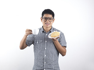 Indian Man holding Asian Pastry and cup