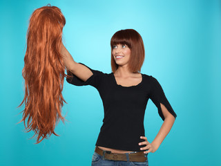 pretty woman admiring long hair wig
