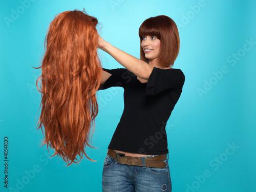 pretty woman admiring long hair wig Plakat