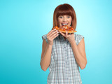 beautiful young woman eating a pizza pie