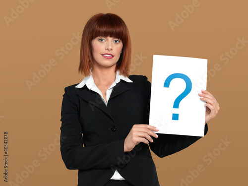 pretty, young businesswoman holding question mark sign