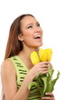 A smiling girl with yellow tulips - isolated on white background
