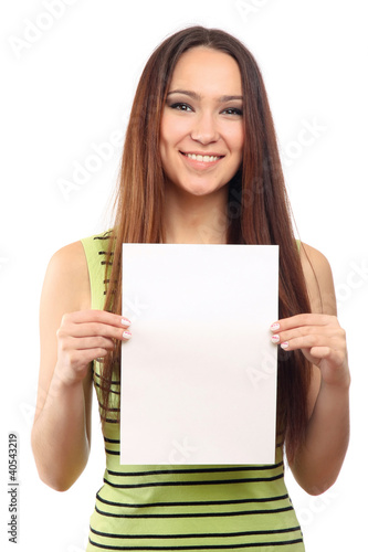 A cute young girl with a blank, isolated on white