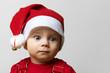 Nachdenkliches Baby zu Weihnachten