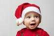 Staunendes Baby an Weihnachten