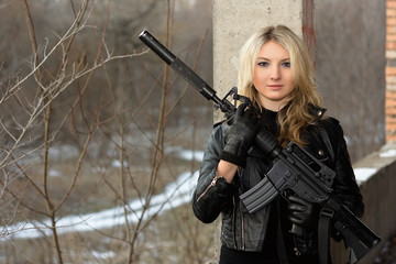 Scared girl with a rifle